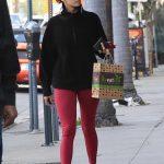 Nina Dobrev in a Red Leggings