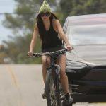 Dakota Johnson in a Green Knit Hat