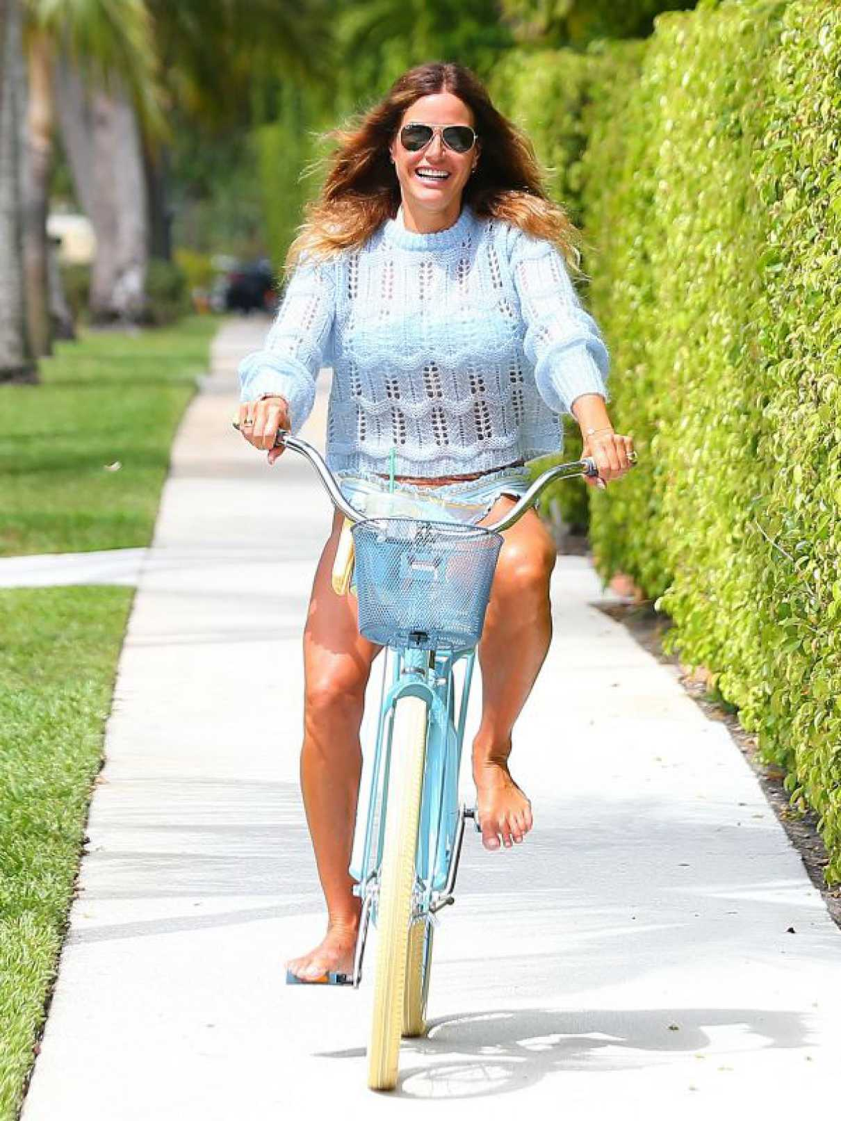 Kelly Bensimon in a Blue Bikini
