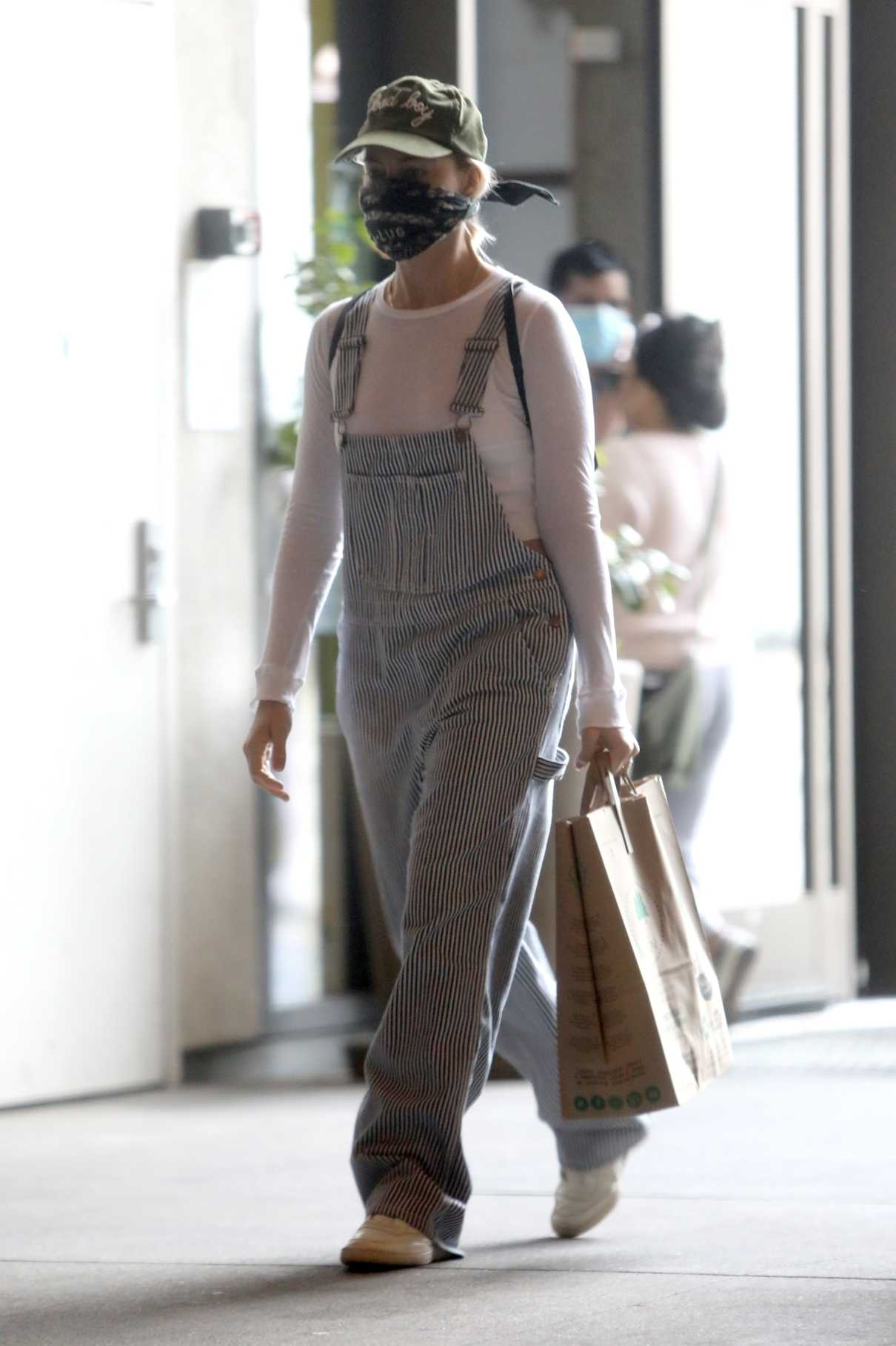 Margot Robbie in a Striped Jumpsuit