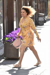 Pandora Christie in a Yellow Floral Dress
