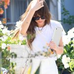 Dakota Johnson in a White Tee Leaves a Friend's Home in Los Angeles 06/25/2020