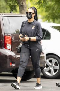 Jordyn Woods in a Black Protective Mask