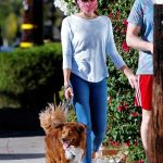 Aubrey Plaza in a White Cap Walks Her Dog Out with Jeff Baena in Los Angeles 07/19/2020