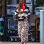 Dakota Johnson in a Red Bandana as a Face Mask