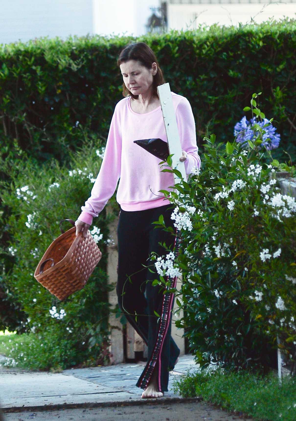Geena Davis in a Pink Sweatshirt