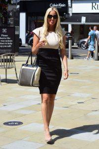 Hayley Palmer in a Beige and Black Mini Dress