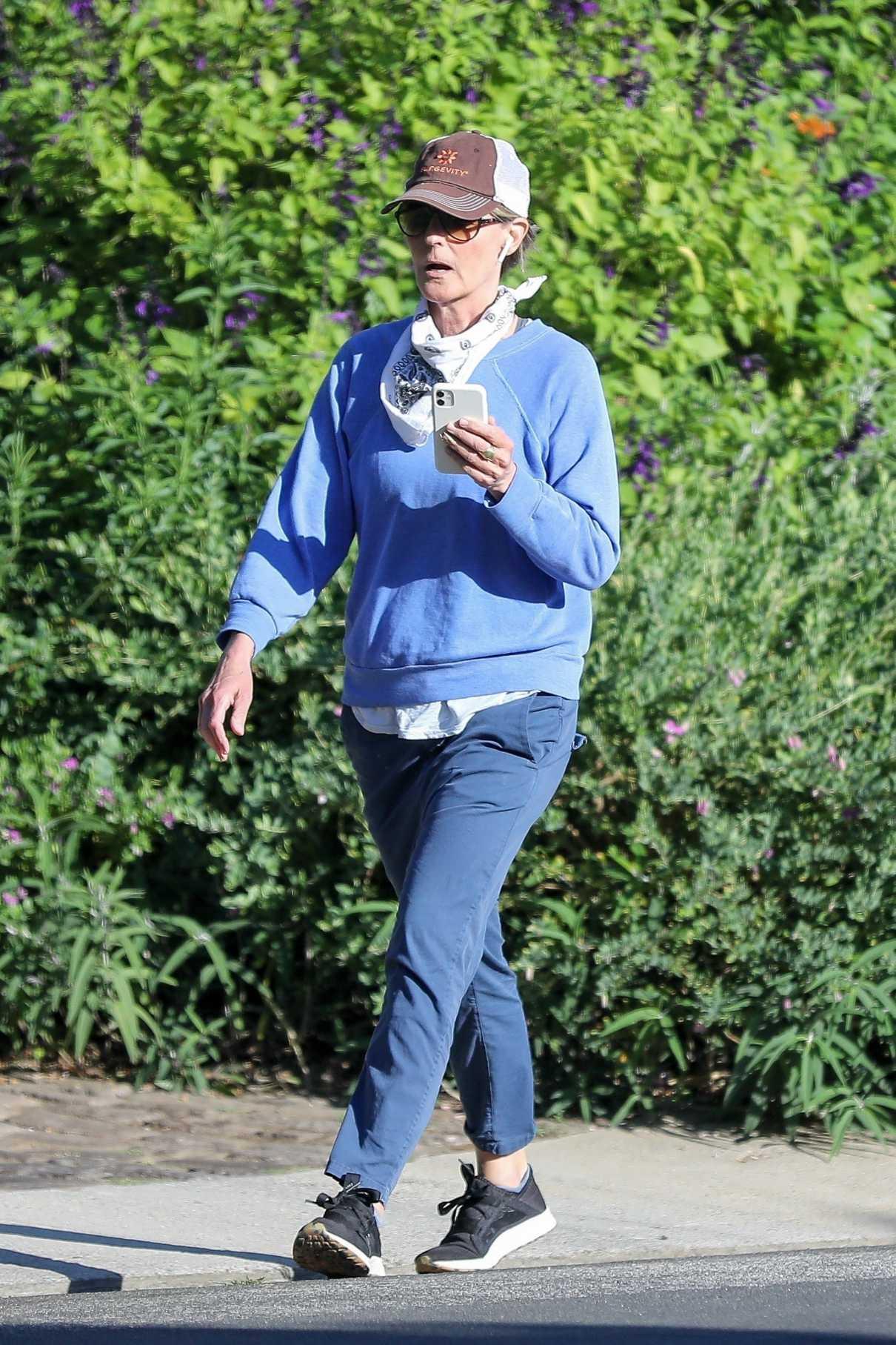 Helen Hunt in a Light Blue Sweatshirt