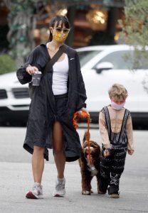 Jordana Brewster in a Black Raincoat