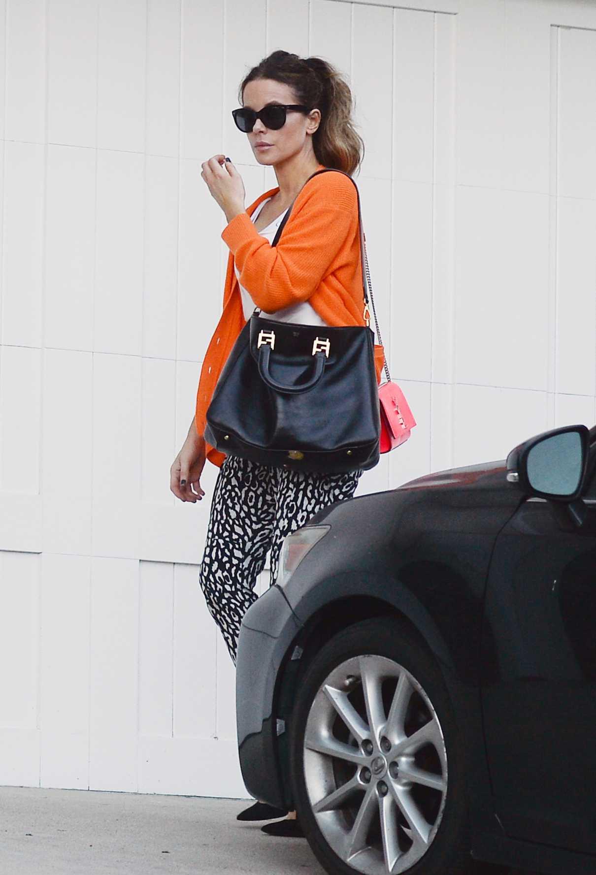 Kate Beckinsale in an Orange Cardigan