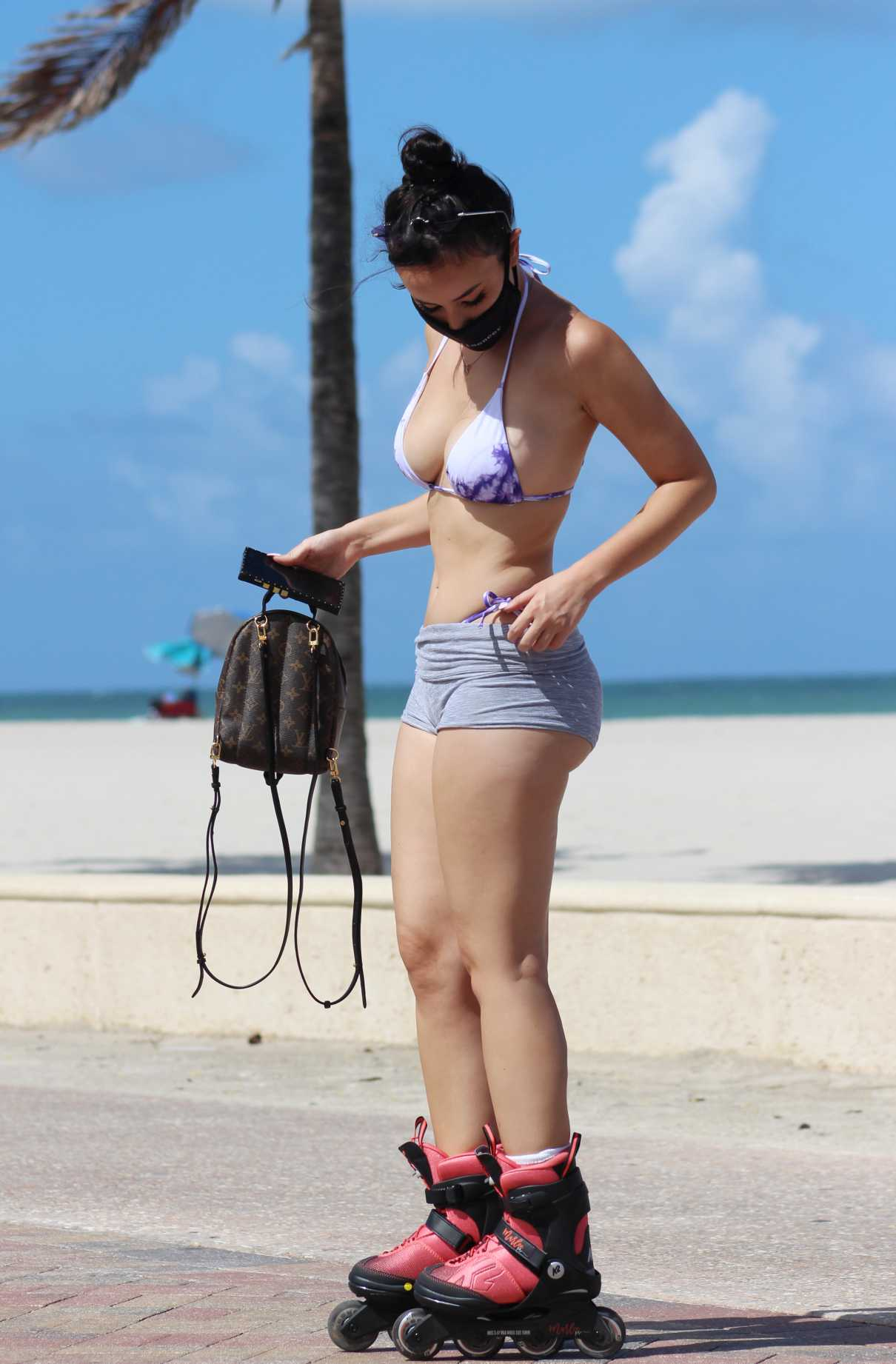 Lisa Opie in a Purple Bikini
