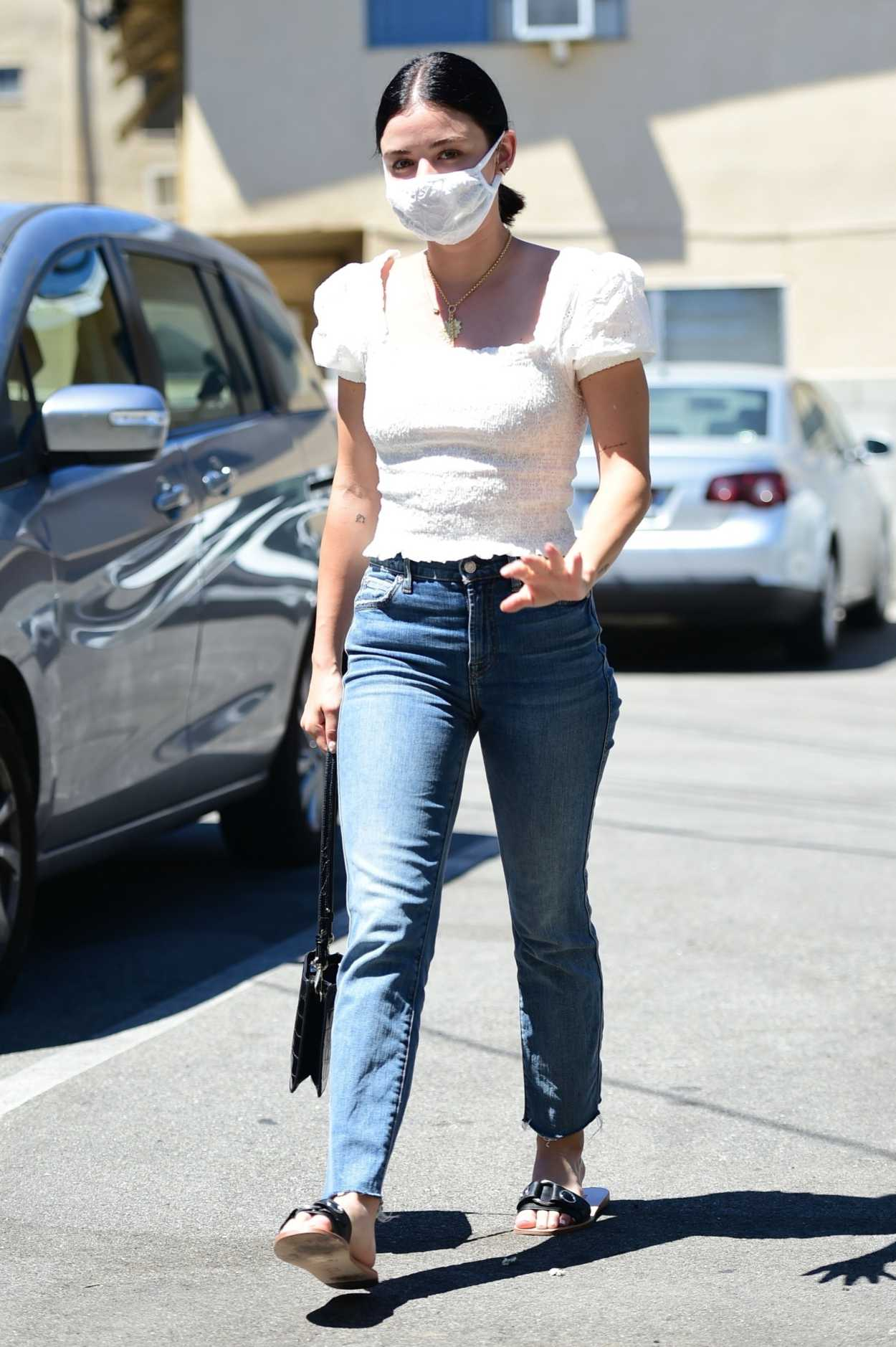 Lucy Hale in a White Blouse