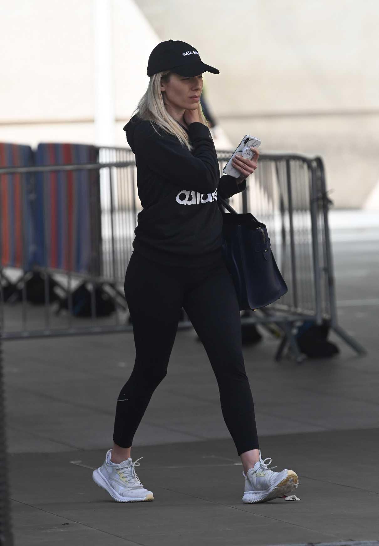 Mollie King in a Black Cap
