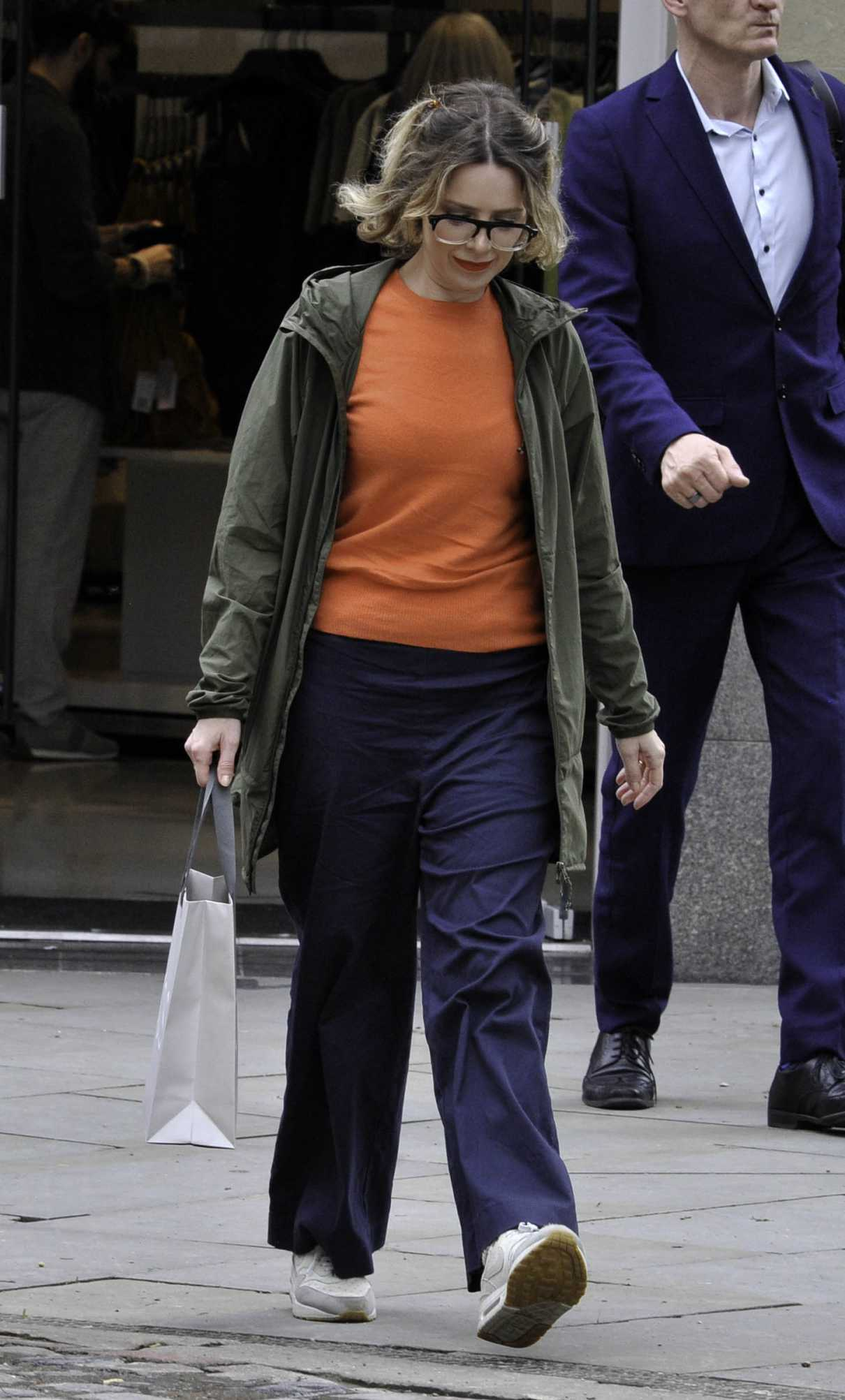 Sally Carman in an Orange Tee