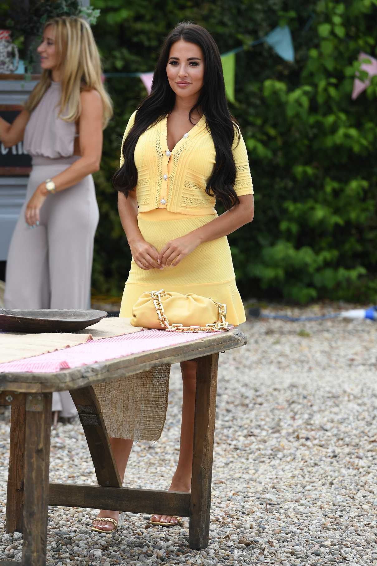 Yazmin Oukhellou in a Yellow Suit