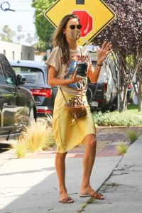 Alessandra Ambrosio in a Yellow Skirt