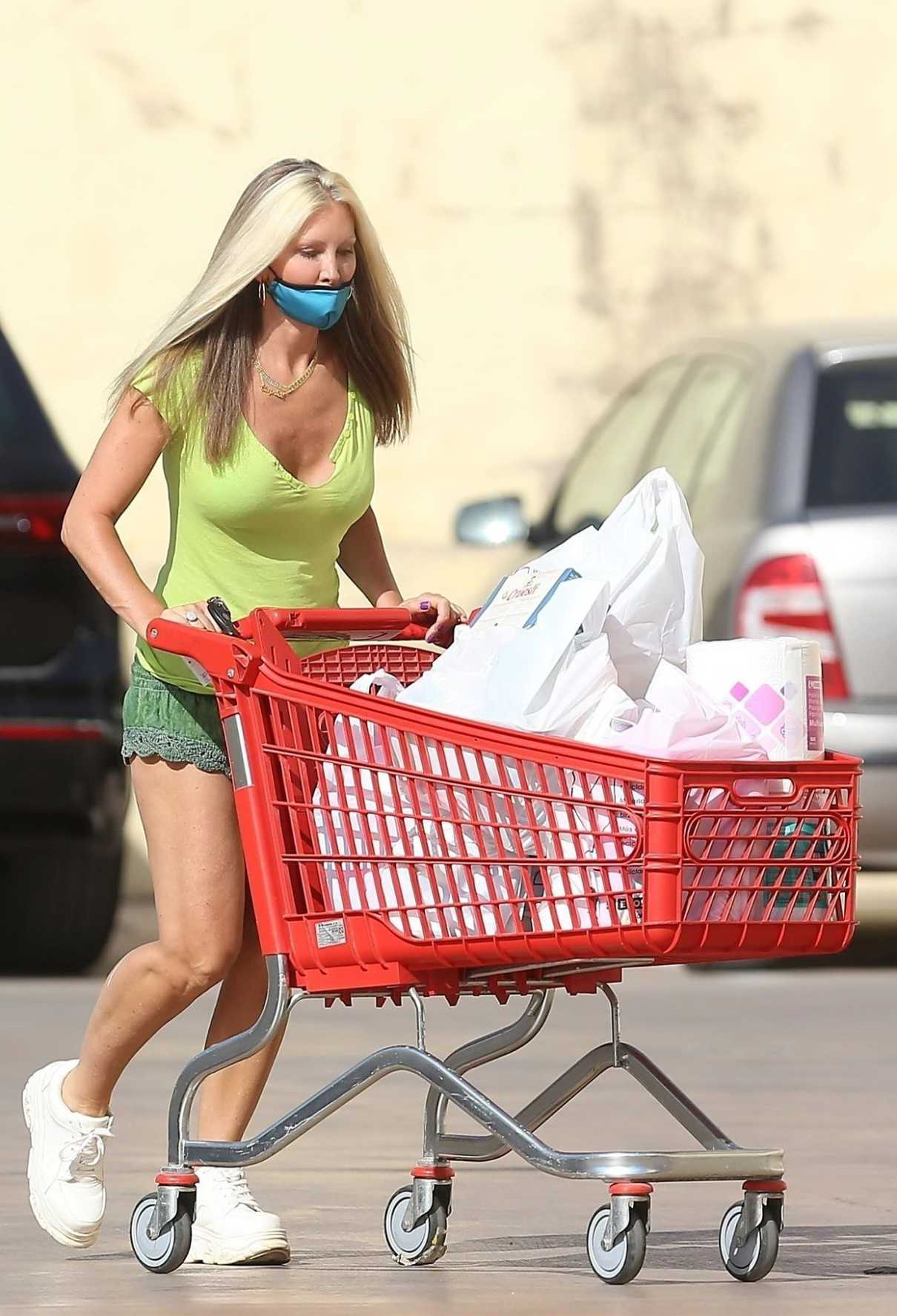 Caprice Bourret in a Protective Mask