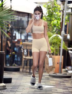 Chantel Jeffries in a Yellow Workout Ensemble