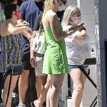 Dakota Fanning in a Neon Green Mini Dress Picks Up Her Food to-Go at Joan's on Third in Studio City 08/29/2020