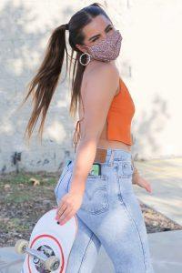 Addison Rae in an Orange Top