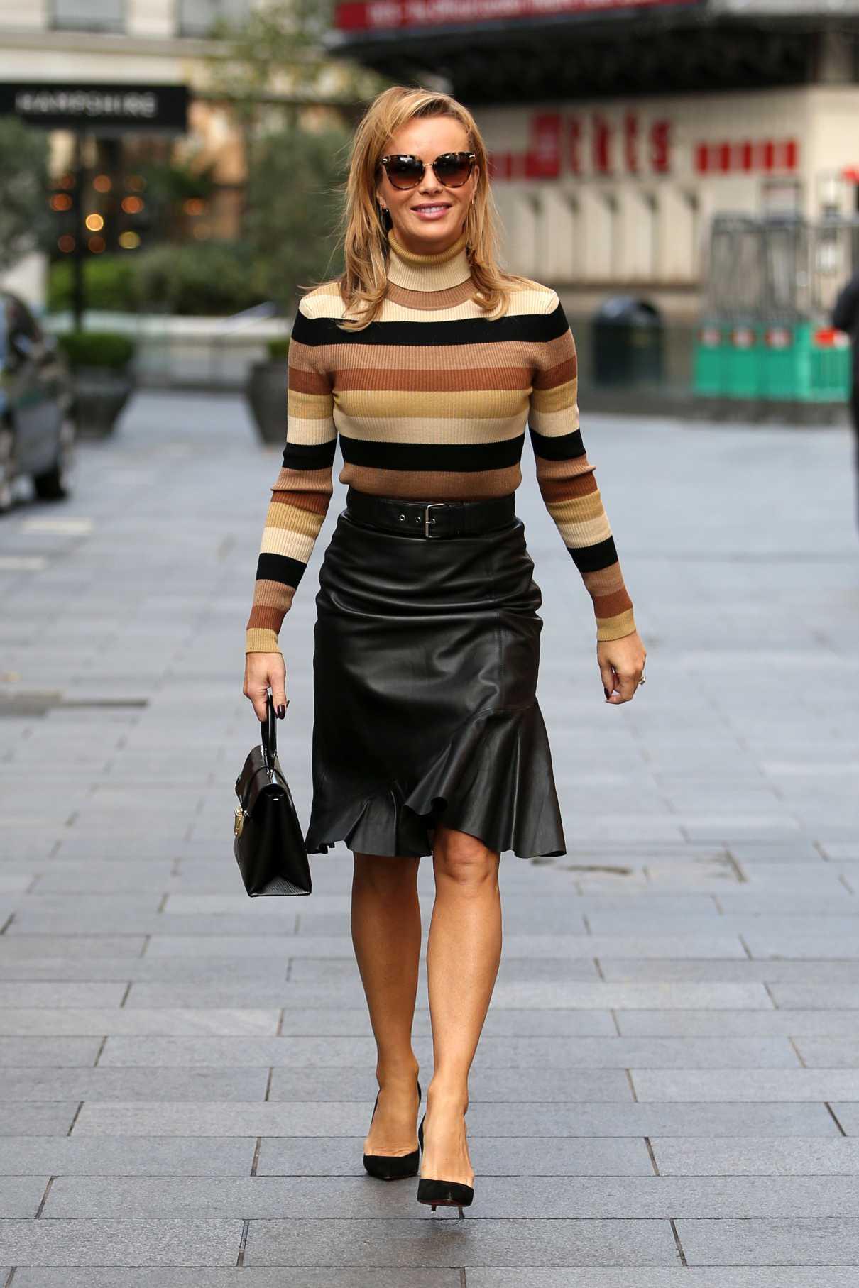 Amanda Holden in a Black Leather Skirt