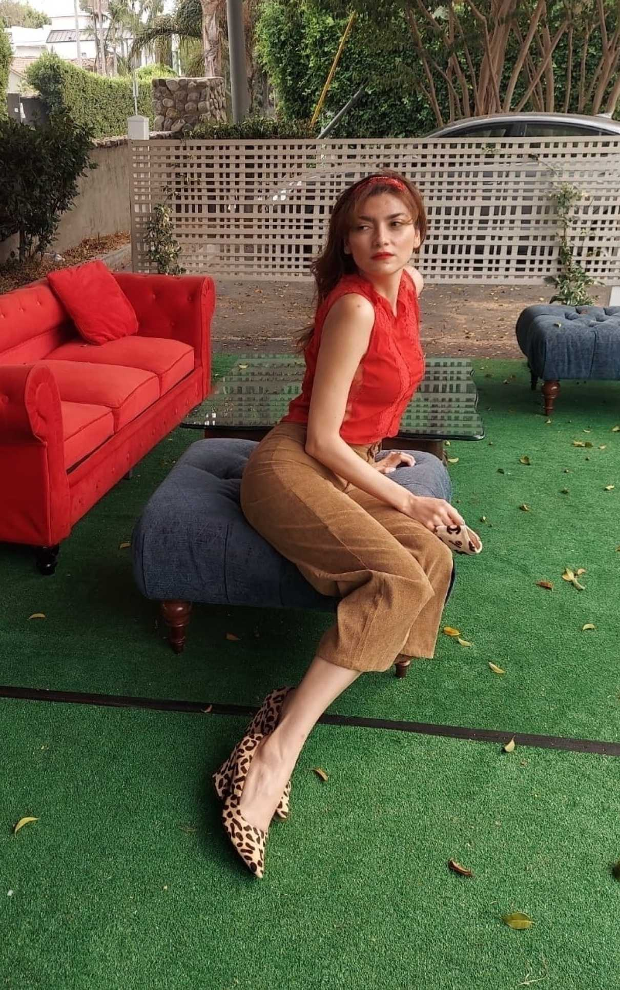 Blanca Blanco in a Red Blouse