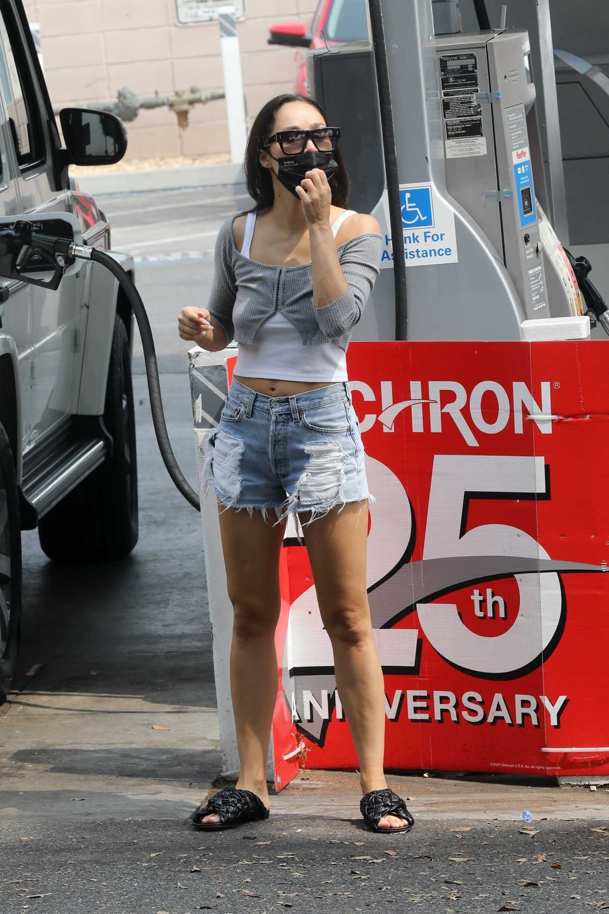 Cara Santana in a Denim Ripped Shorts