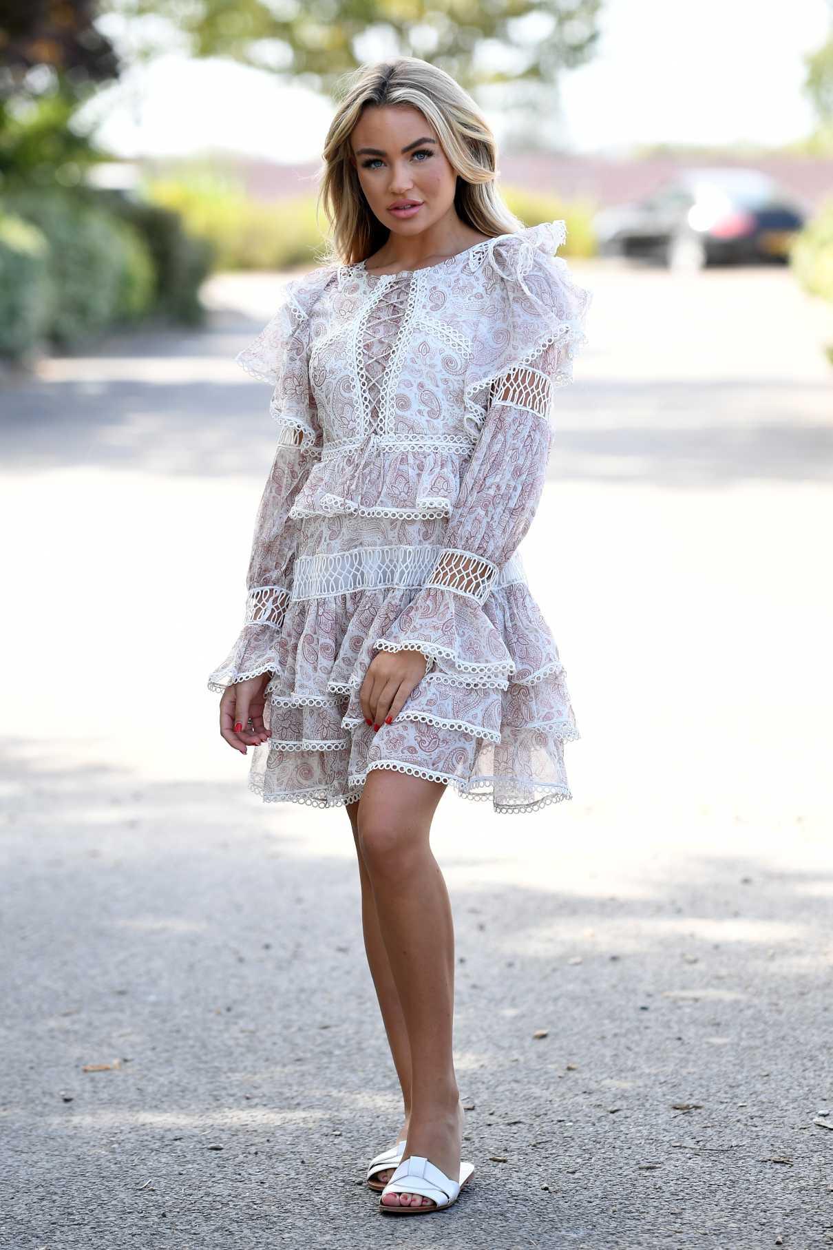 Ella Rae Wise in a White Dress