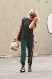 Emma Slater in a Black Sneakers