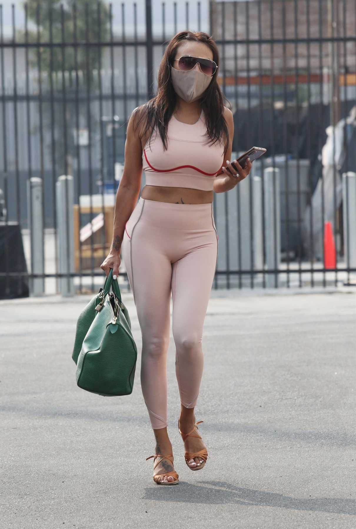 Jeannie Mai in a Beige Exercise Outfit