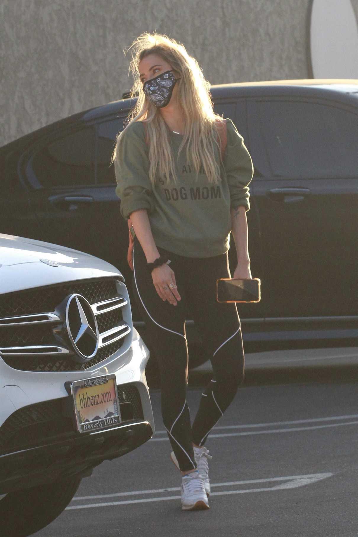 Kaitlyn Bristowe in an Olive Sweatshirt