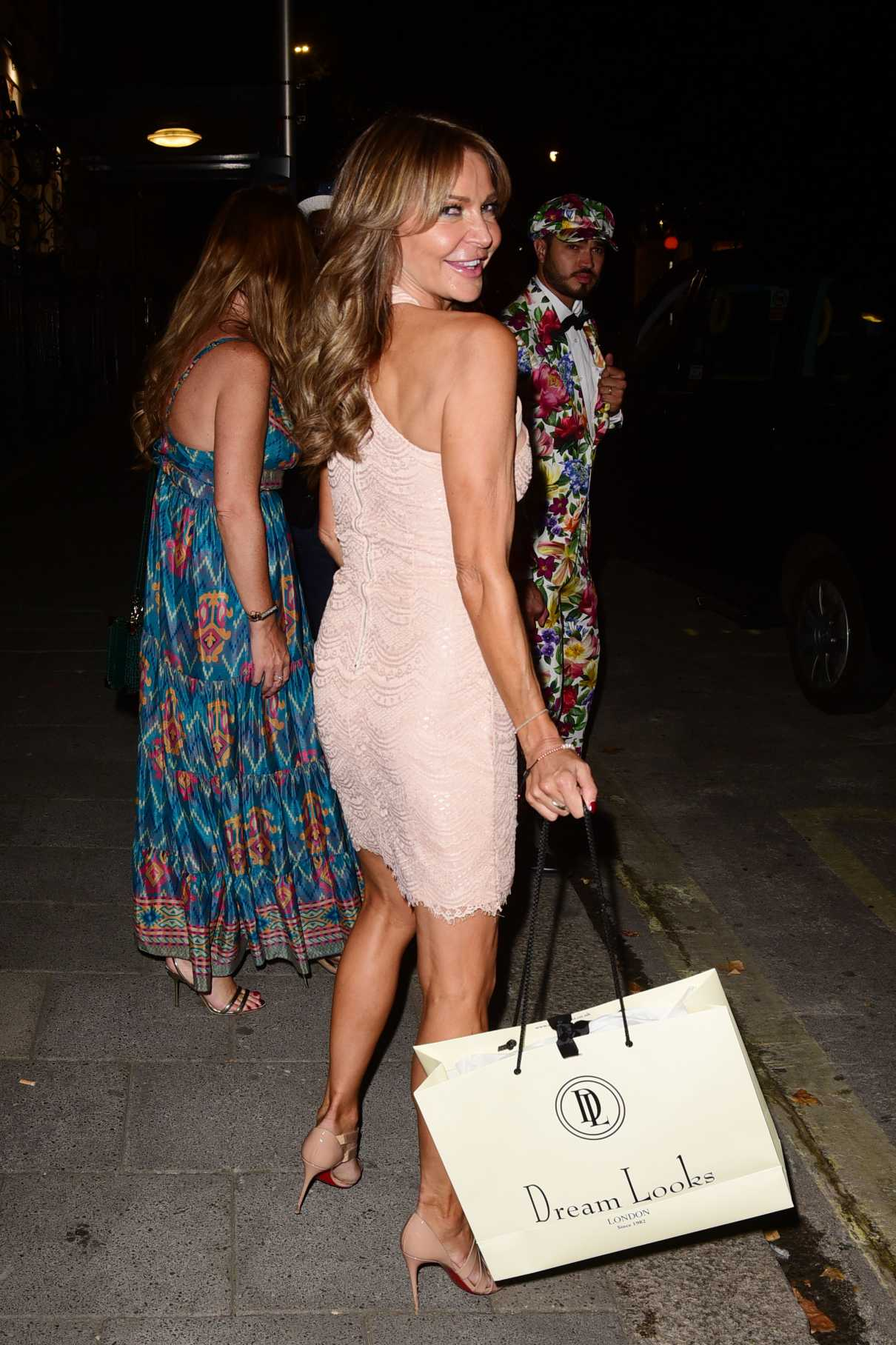 Lizzie Cundy in a Beige Dress