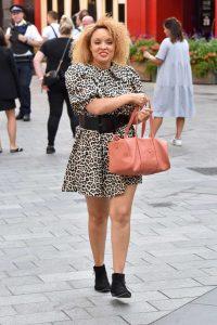 Pandora Christie in an Animal Print Dress