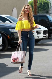 Chrishell Stause in a Yellow Top