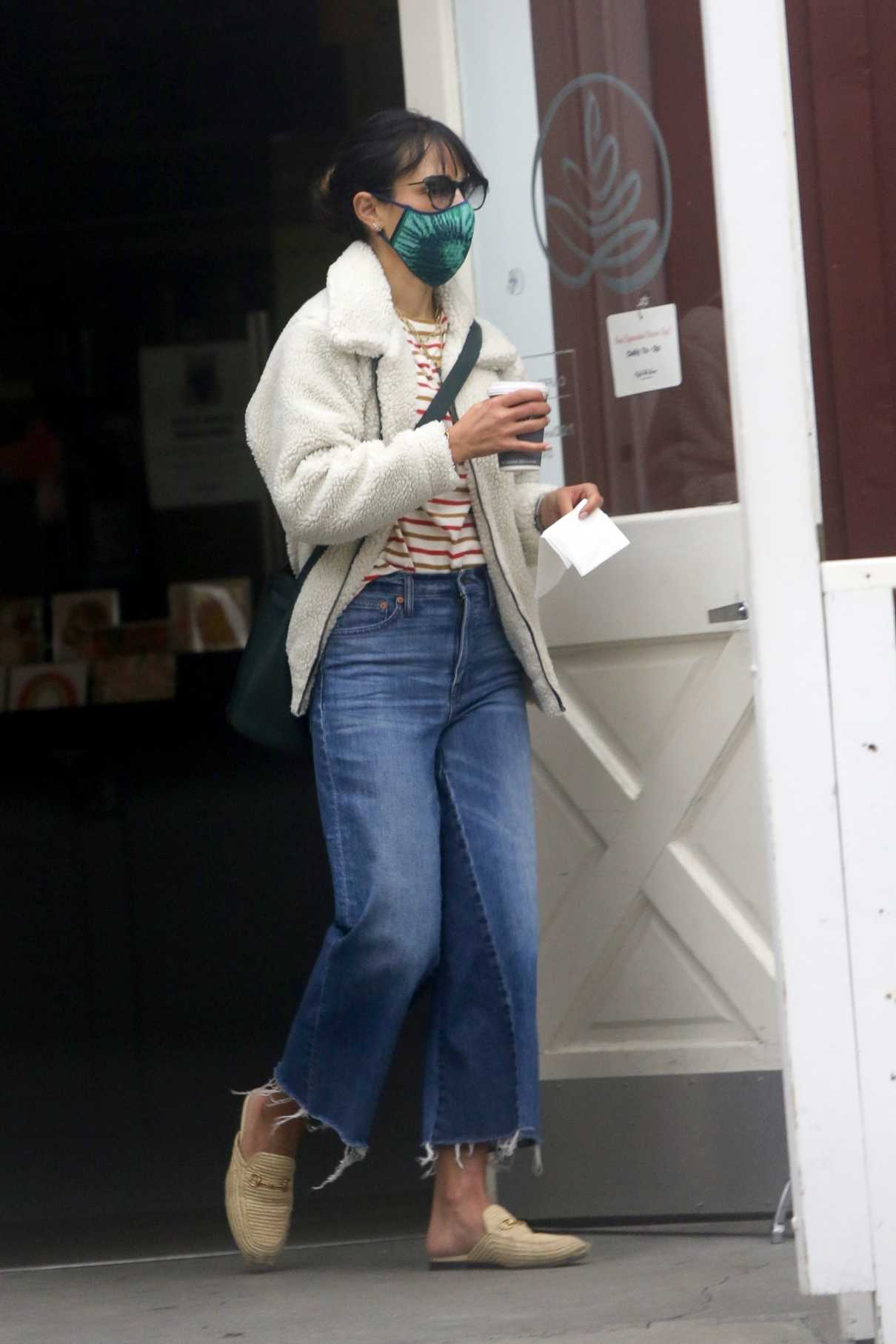 Jordana Brewster in a Green Protective Mask