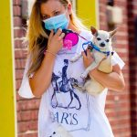 Kaley Cuoco in a White Tee Carries Her Dog Out on a Morning Stroll in New York City 09/30/2020