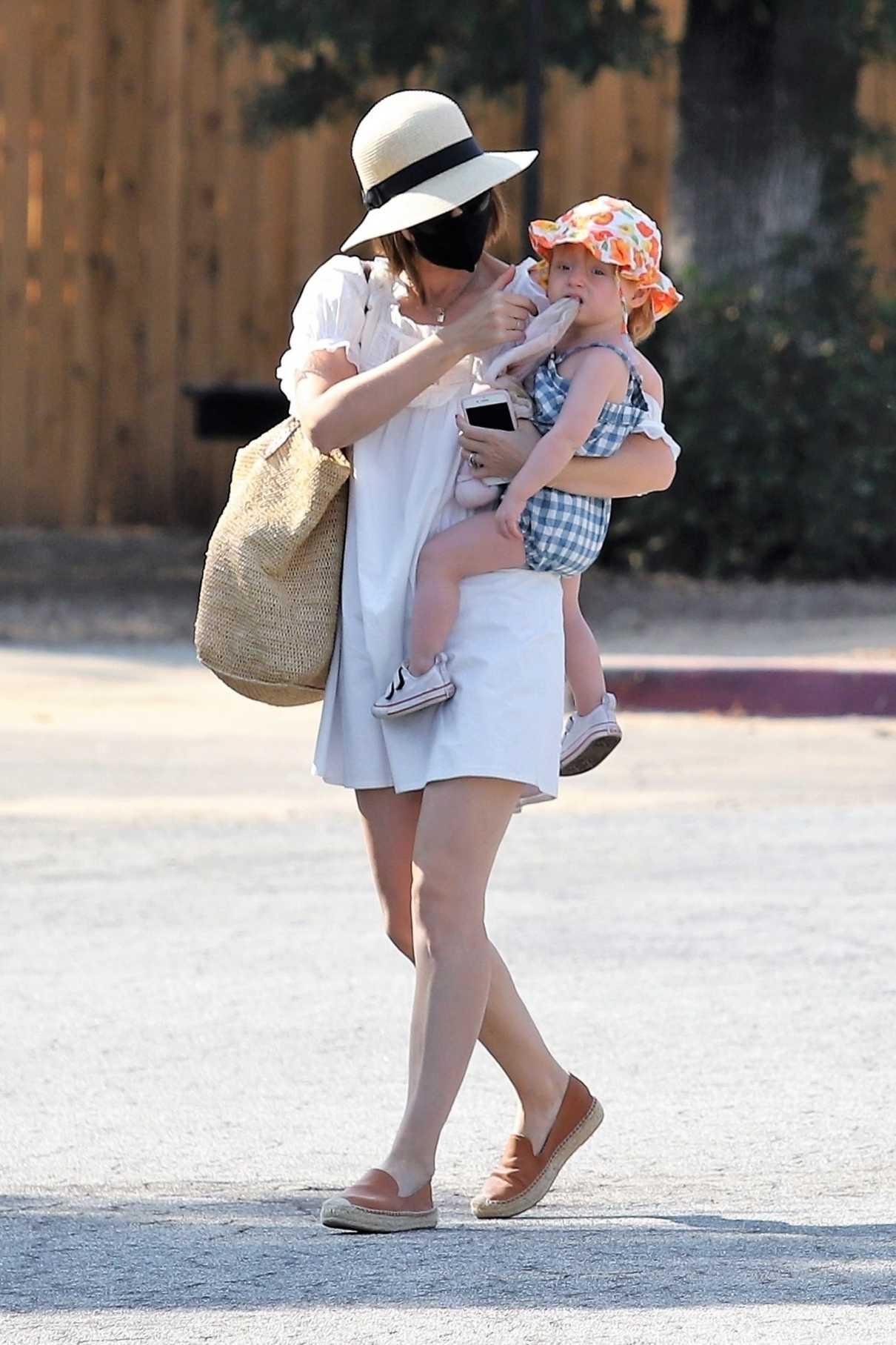 Kate Mara in a White Mini Dress