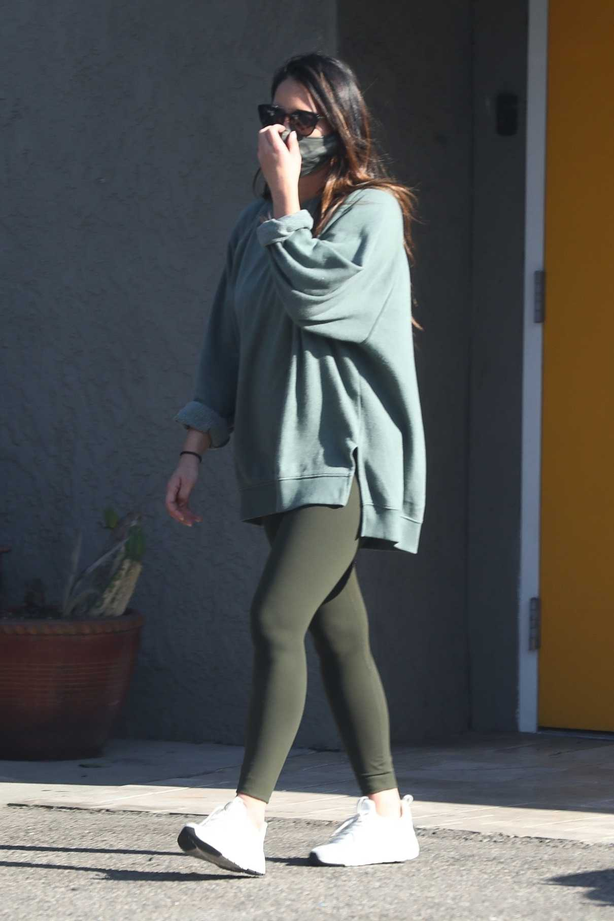 Olivia Munn in an Olive Leggings