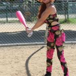 Phoebe Price in a Floral Workout Ensemble Trying Her Hand with Baseball with a Giant Pink Bat in Los Angeles 10/11/2020