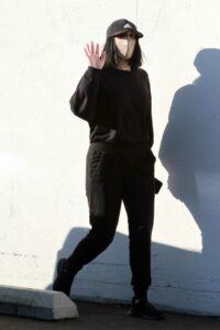 Cheryl Burke in a Black Cap