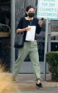 Courteney Cox in a Black Protective Mask