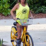 Katie Price in a Neon Green Tank Top Does a Bike Ride at the Kandima Resort in the Maldives 10/30/2020