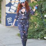 Phoebe Price in a Blue Cap Stops to Strike a Pose while Shopping with Her Dog in Hollywood 11/24/2020