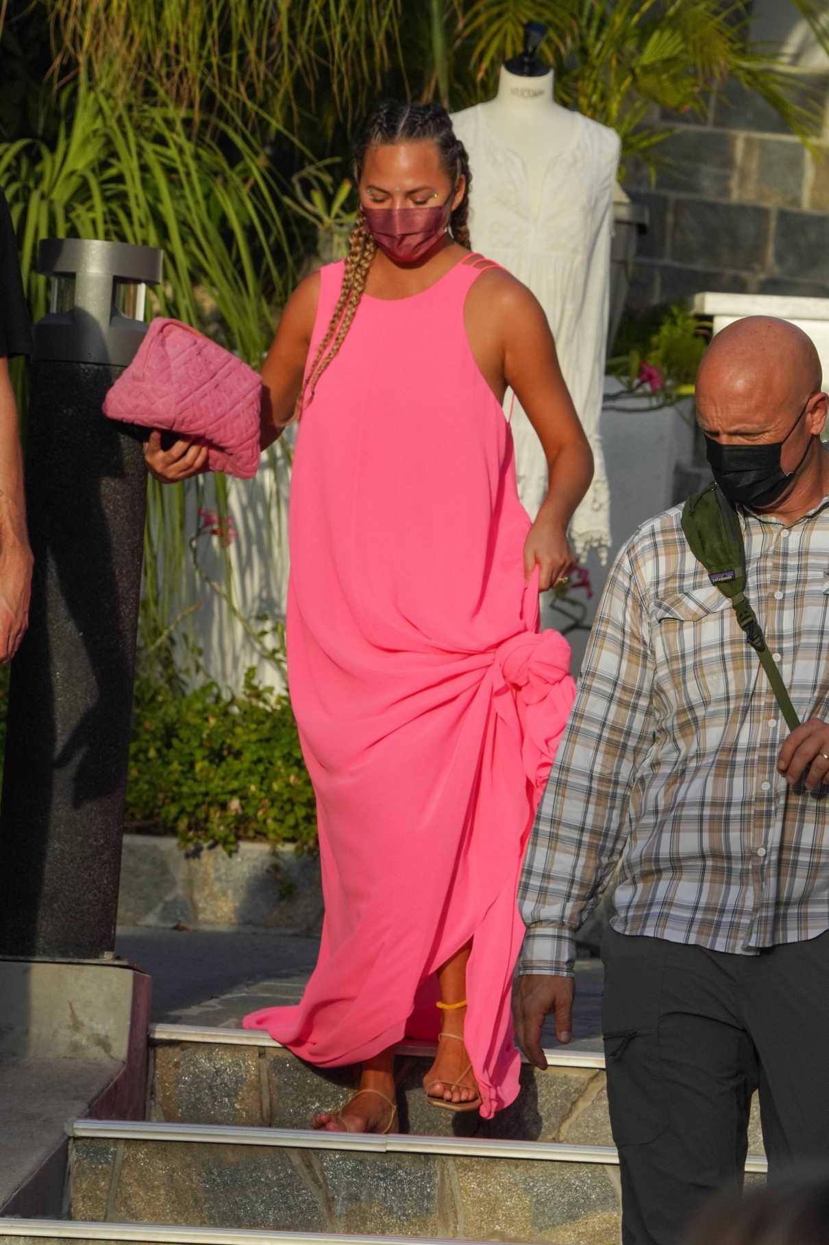 Chrissy Teigen in a Pink Dress