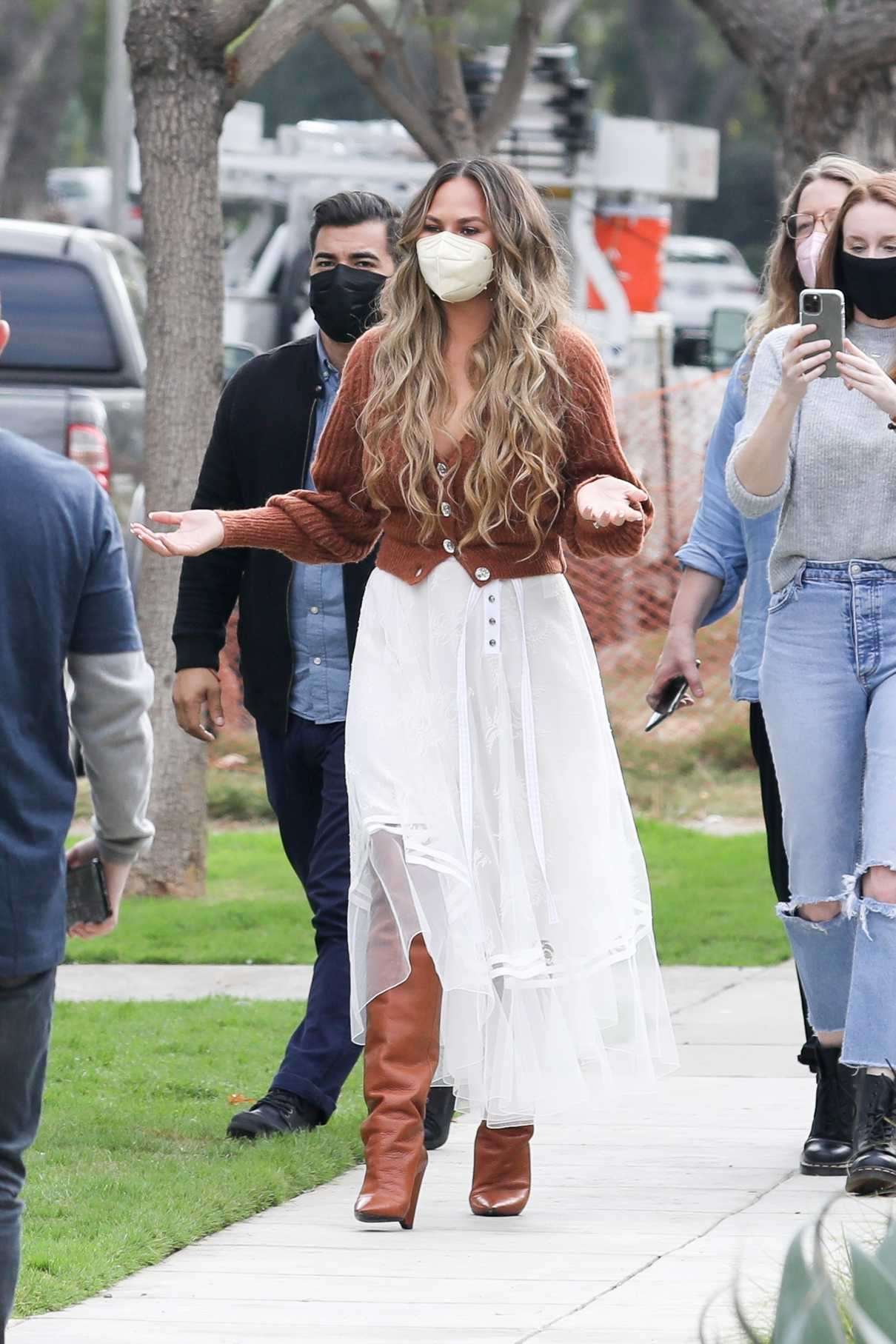Chrissy Teigen in a Protective Mask