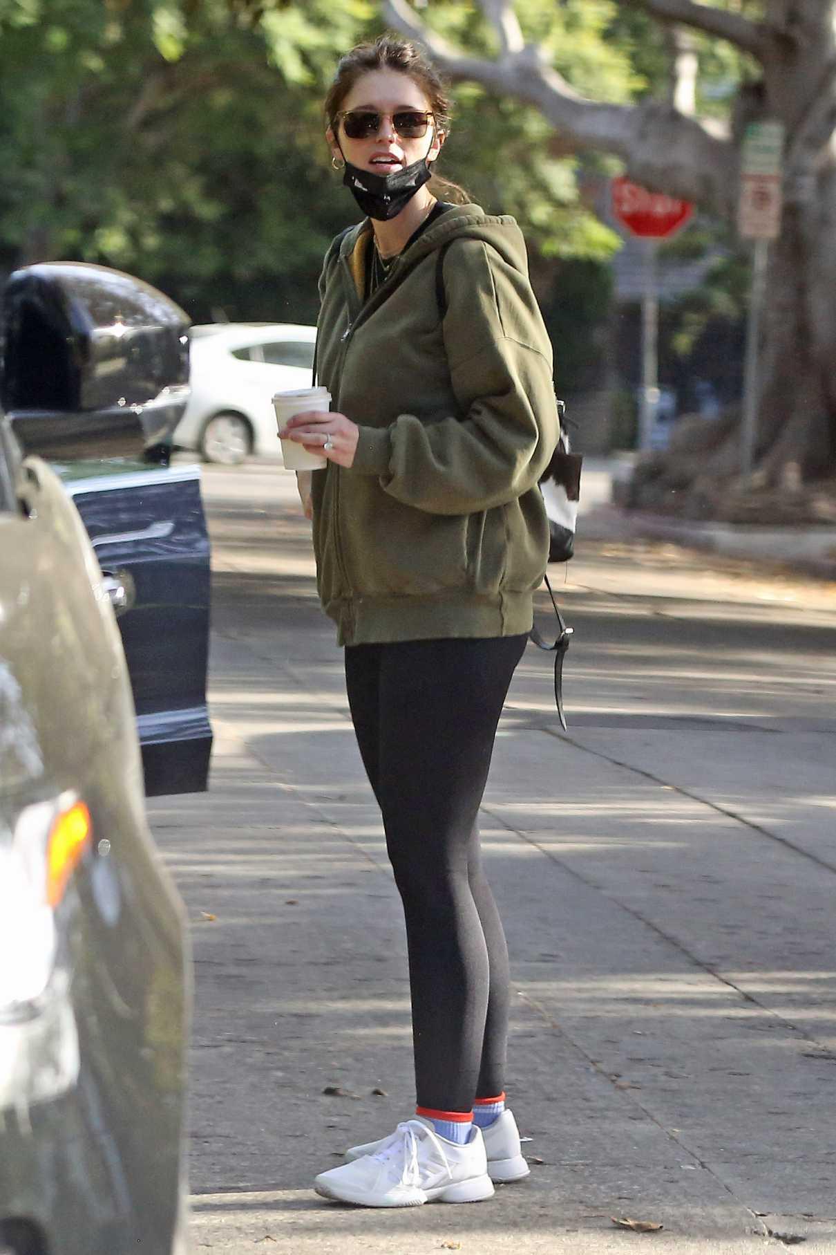 Katherine Schwarzenegger in an Olive Sweatsuit