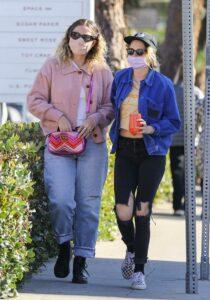 Kristen Stewart in a Black Ripped Jeans
