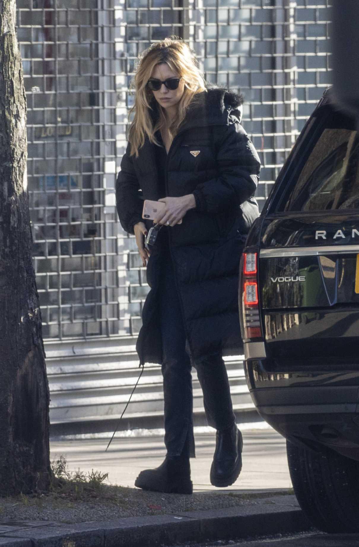 Abbey Clancy in a Black Puffer Coat