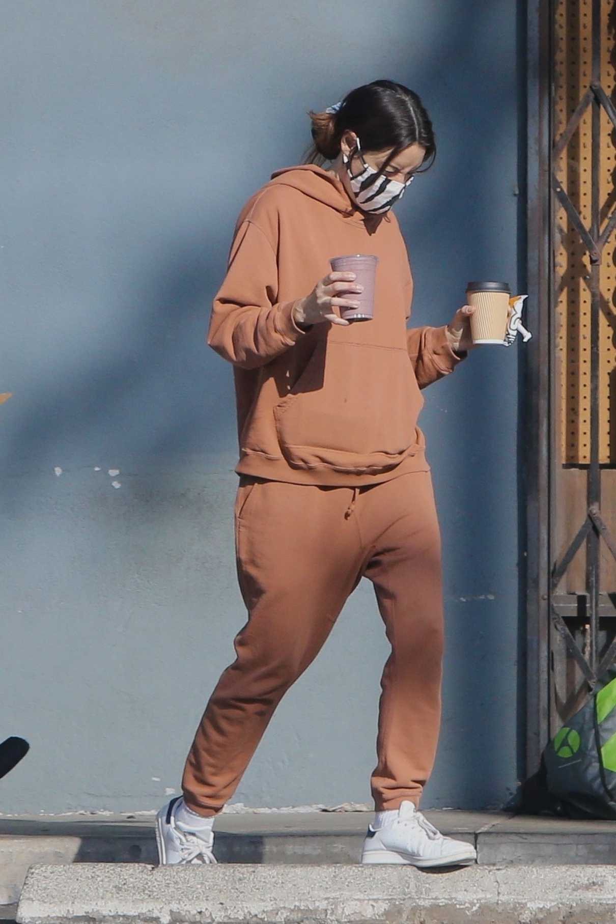 Aubrey Plaza in a Tan Sweatsuit