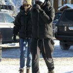 Dakota Johnson in a Beige Knit Hat Was Seen Out with Chris Martin at Buttermilk Ski Area in Aspen 12/30/2020